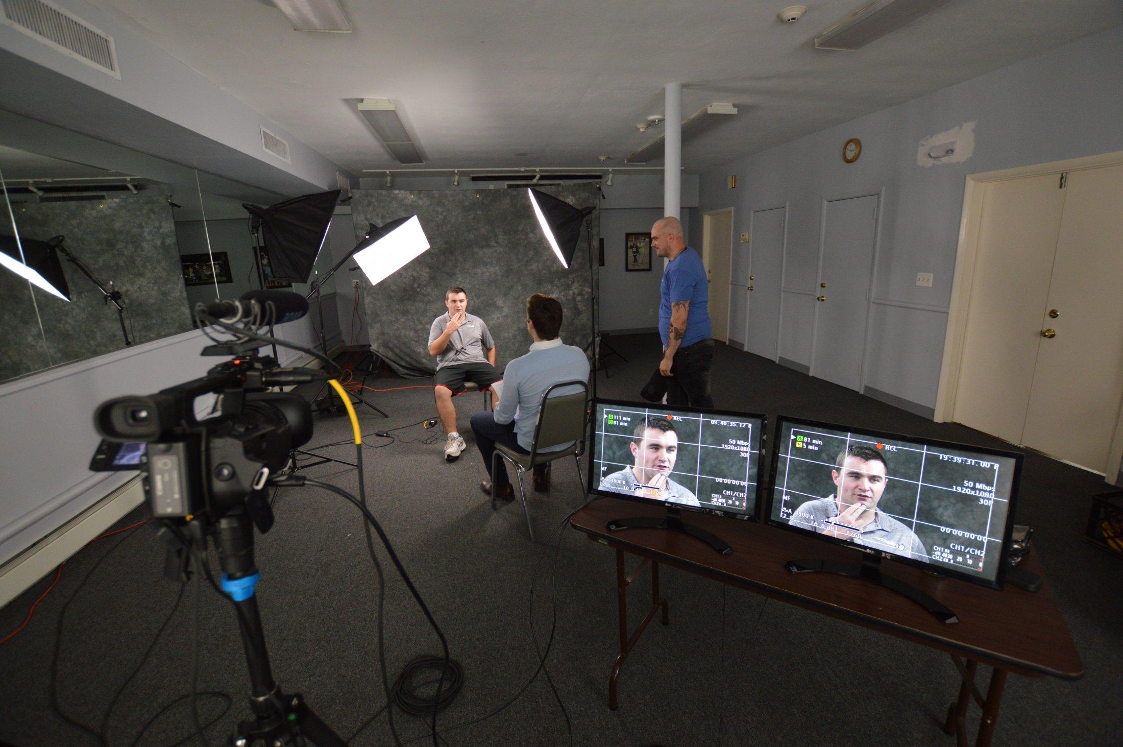 Stephen filming while Patrick interviews Brian Murtha