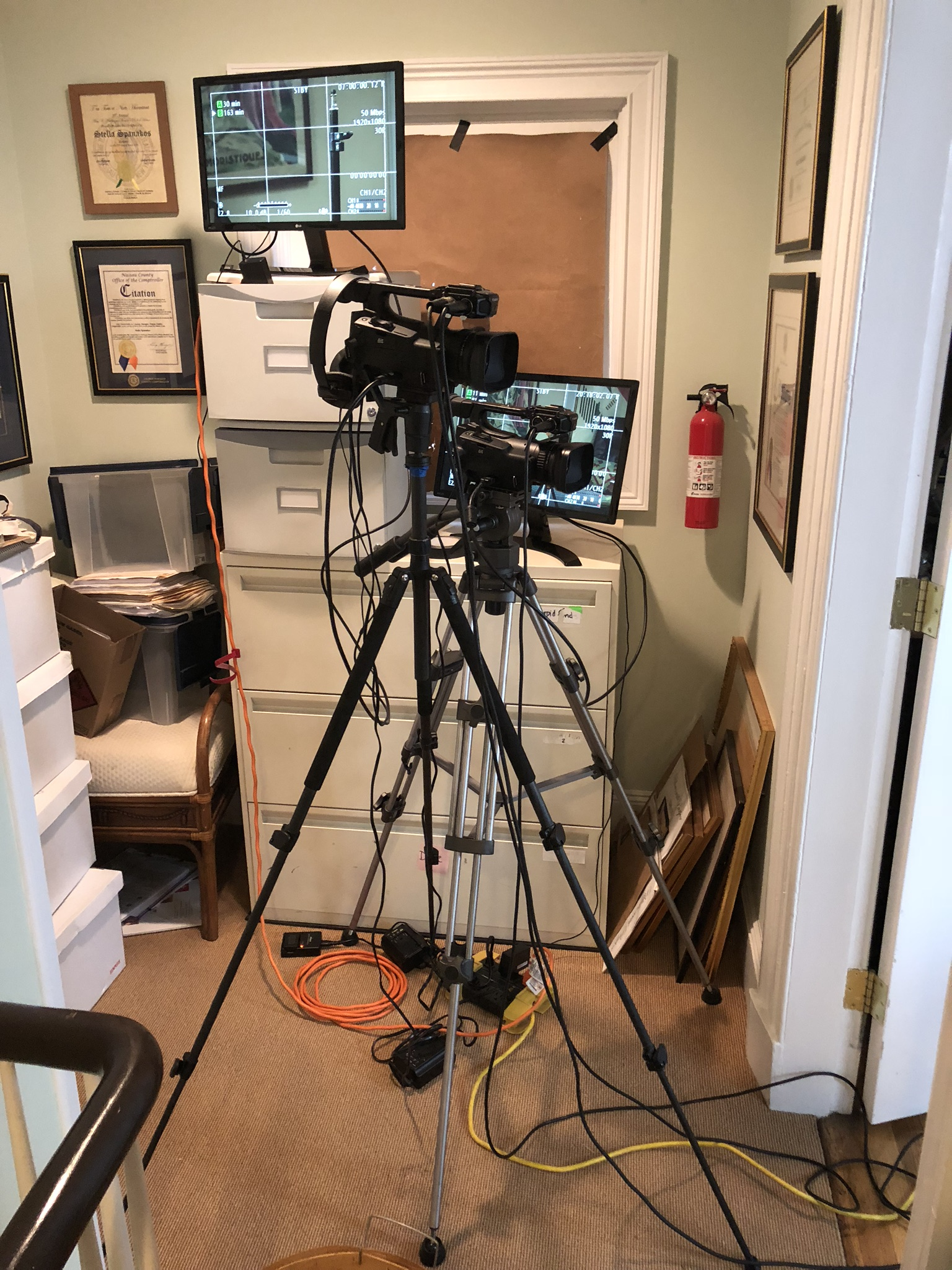Cameras setup in hall outside Stella's office
