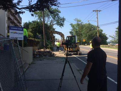 Filming broll of the front exterior demolition